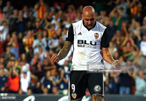 Simone Zaza of Valencia celebrates scoring his team's third goal during the La Liga match between Valencia and Malaga at Estadio Mestalla on...