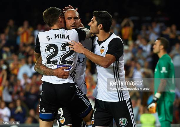 Simone Zaza of Valencia celebrates scoring his team's third goal with his teammates Santi Mina and Goncalo Guedes during the La Liga match between...