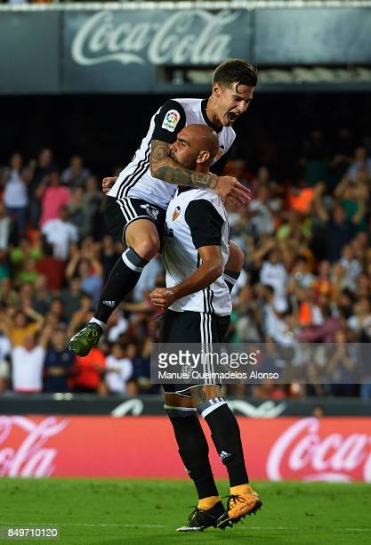 Simone Zaza of Valencia celebrates scoring his team's third goal with his teammate Santi Mina during the La Liga match between Valencia and Malaga at...
