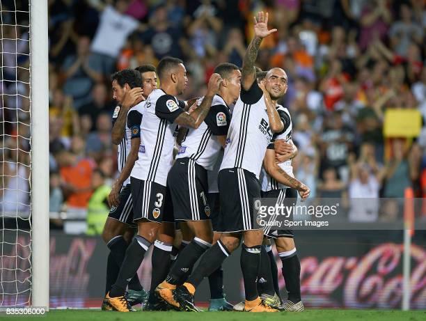 Simone Zaza of Valencia celebrates with his teammates after scoring a goal during the La Liga match between Valencia and Las Palmas at Estadio...