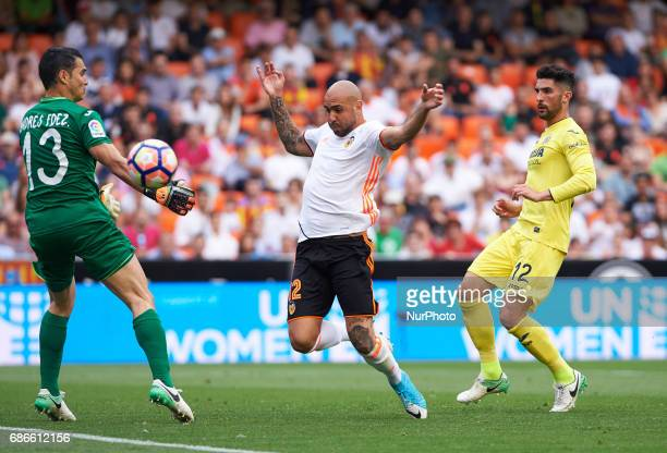 Simone Zaza of Valencia CF and Alvaro Gonzalez and Andres Fernandez of Villarreal CF during their La Liga match between Valencia CF and Villarreal CF...