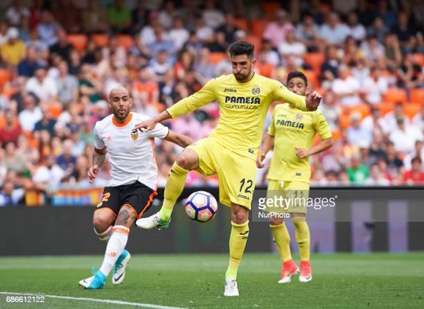 Simone Zaza of Valencia CF and Alvaro Gonzalez of Villarreal CF during their La Liga match between Valencia CF and Villarreal CF at the Mestalla...