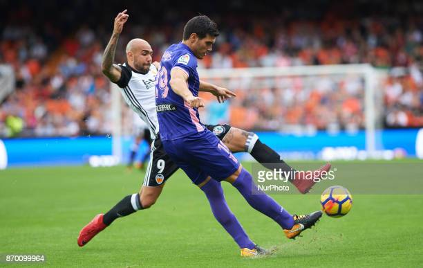 Simone Zaza of Valencia CF and Ezequiel Munoz of Club Deportivo Leganes in action during the La Liga match between Valencia CF and Club Deportivo...