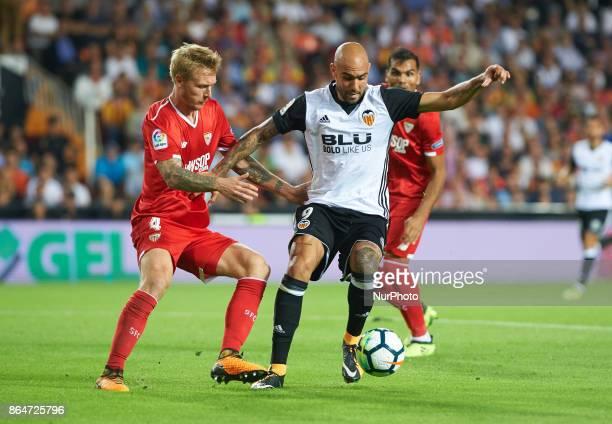 Simone Zaza of Valencia CF and Simon Kjaer of Sevilla FC in action during the La Liga match between Valencia CF and Sevilla FC at Estadio Mestalla on...