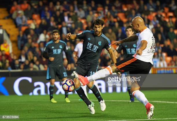Simone Zaza of Valencia CF and Xabi Prieto of Real Sociedad during their La Liga match between Valencia CF and Real Sociedad at the Mestalla Stadium...