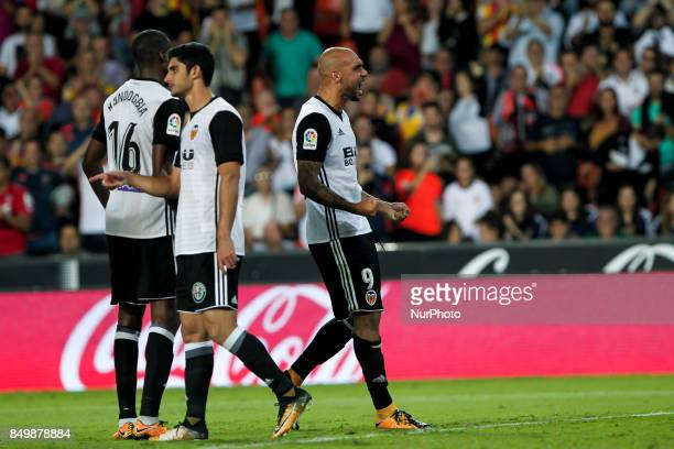 09 Simone Zaza of Valencia CF celebrate after scoring the 40 goal with his teammate during spanish La Liga match between Valencia CF vs Malaga CF at...