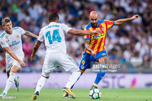 Simone Zaza of Valencia CF fights for the ball with Carlos Henrique Casemiro of Real Madrid during their La Liga 201718 match between Real Madrid and...