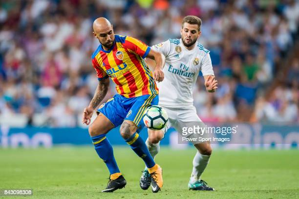Simone Zaza of Valencia CF fights for the ball with Nacho Fernandez of Real Madrid during their La Liga 201718 match between Real Madrid and Valencia...