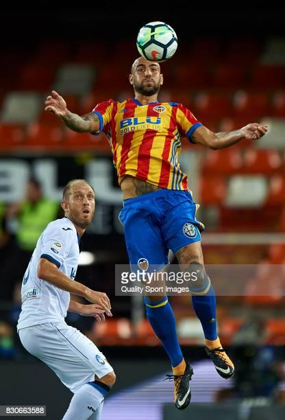 Simone Zaza of Valencia competes for the ball with Andrea Masiello of Atalanta during the preseason friendly match between Valencia CF and Atalanta...