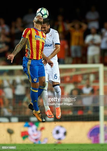 Simone Zaza of Valencia competes for the ball with Luis Palomino of Atalanta during the preseason friendly match between Valencia CF and Atalanta BC...