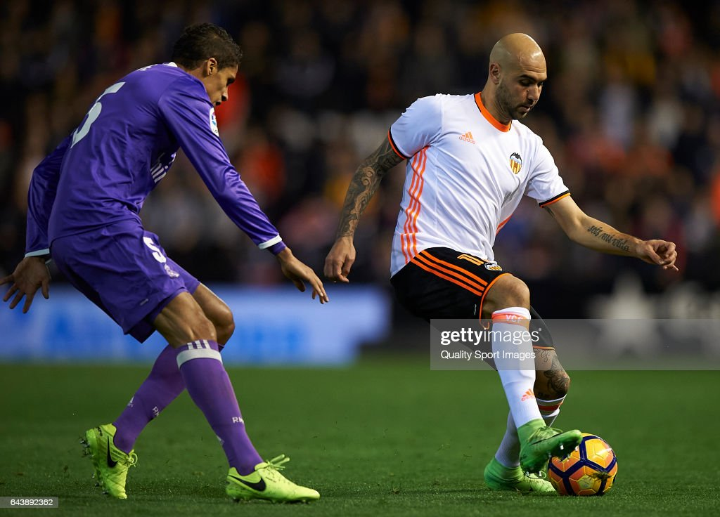 Simone Zaza (R) of Valencia competes for the ball with Raphael Varane of Real Madrid during the La Liga match between Valencia CF and Real Madrid at Mestalla Stadium on February 22, 2017 in Valencia, Spain.