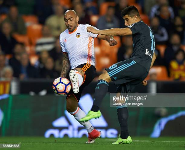 Simone Zaza of Valencia competes for the ball with Yuri Berchiche Izeta of Real Sociedad during the La Liga match between Valencia CF and Real...