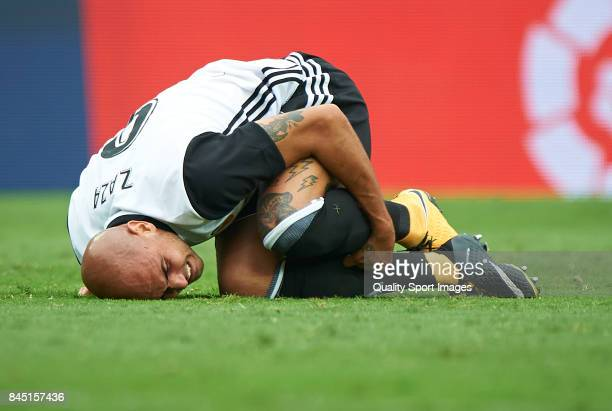 Simone Zaza of Valencia lies on the pitch during the La Liga match between Valencia and Atletico Madrid at on September 9 2017 in Valencia