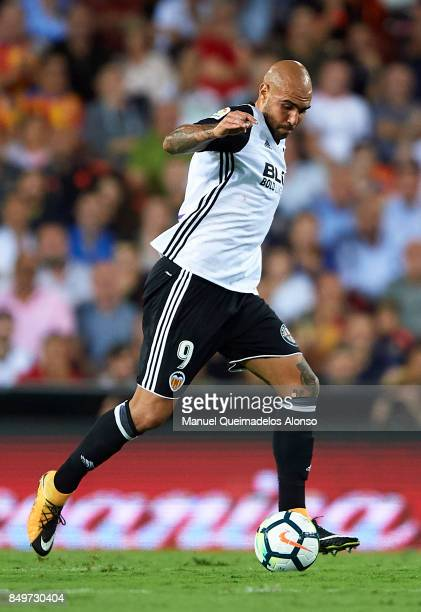 Simone Zaza of Valencia runs with the ball during the La Liga match between Valencia and Malaga at Estadio Mestalla on September 19 2017 in Valencia...