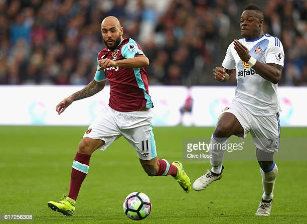 Simone Zaza of West Ham United and Lamine Koné of Sunderland both compete for the ball during the Premier League match between West Ham United and...