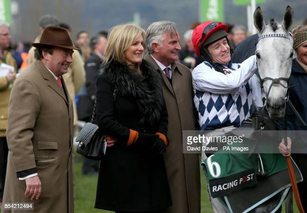 Simonsig and jockey Barry Geraghty with trainer Nicky Henderson after winning the Racing Post Arkle Challenge Trophy Chase during day one of the 2013...