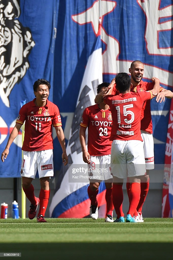 Simovic of Nagoya Grampus celebrates the opener with Lee Seung Hee of Nagoya Grampus during the J.League match between Nagoya Grampus and Yokohama F.Marinos at the Toyota Stadium on May 4, 2016 in Toyota, Aichi, Japan.