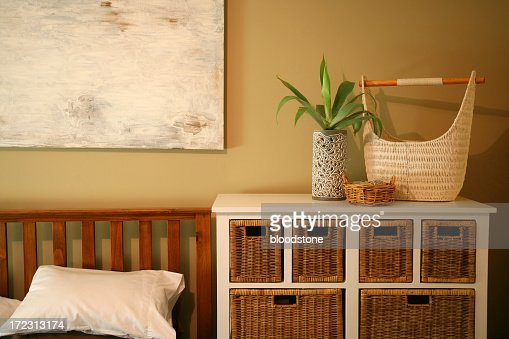 Simple bedroom decor with brown baskets