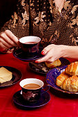 Simple delicious meal - freshly baked croissants, butter and cup of tea