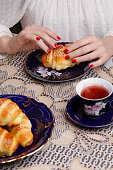 Simple delicious meal - freshly baked croissants with cup of tea
