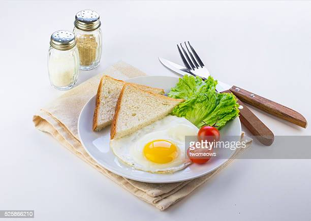 Simple english breakfast served on white dining table.