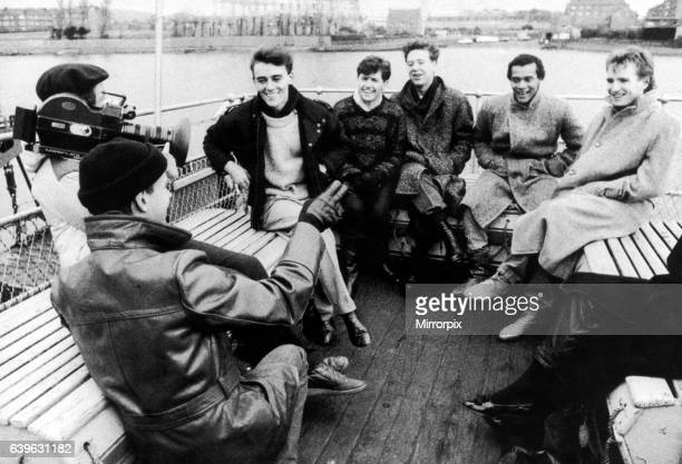 Simple Minds filming on the Clyde in front of Barrowland Glasgow Scotland 22nd November 1983 Left to right Mick MacNeill Charlie Burchill Jim Kerr...