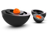 Nesting spheres with an orange core and black shell, symbol of uniqueness. 3D render over white background