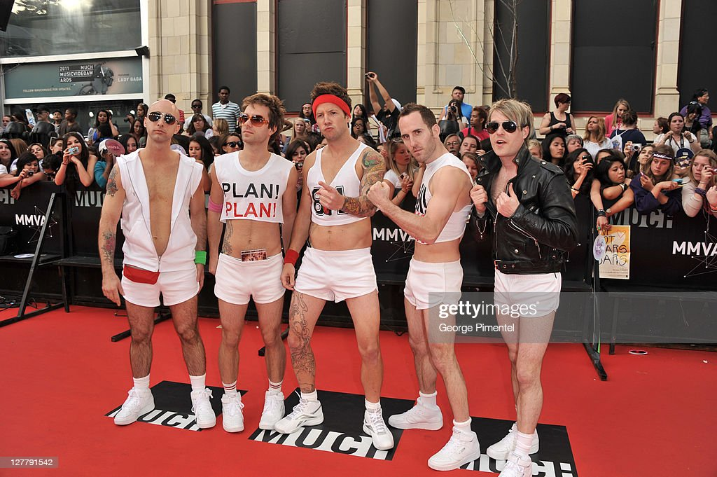 <a gi-track='captionPersonalityLinkClicked' href=/galleries/search?phrase=Simple+Plan&family=editorial&specificpeople=239220 ng-click='$event.stopPropagation()'>Simple Plan</a> arrive on the red carpet at the 22nd Annual MuchMusic Video Awards at the MuchMusic HQ on June 19, 2011 in Toronto, Canada.
