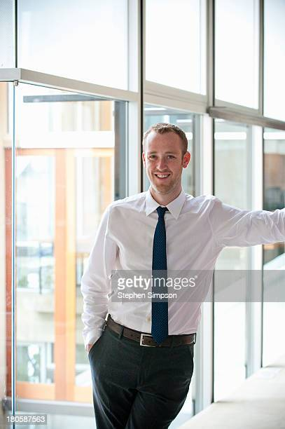 simple portrait, businessman and glass wall