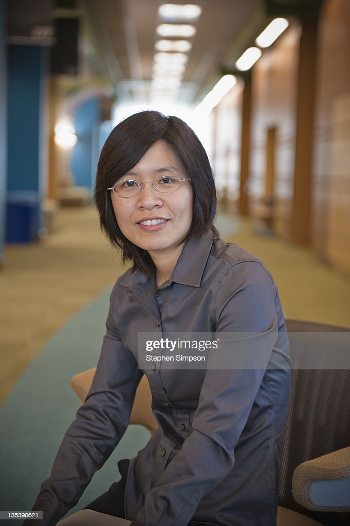 simple portrait, businesswoman in hallway : Stock Photo