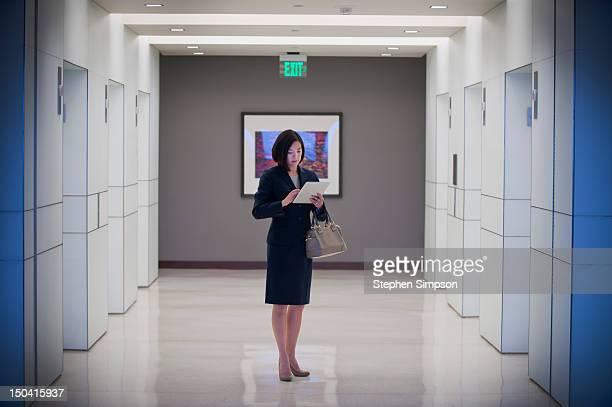 simple portrait, businesswoman w/tablet computer