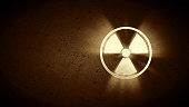A simple radiation warning design in sepia tone on a concrete background.