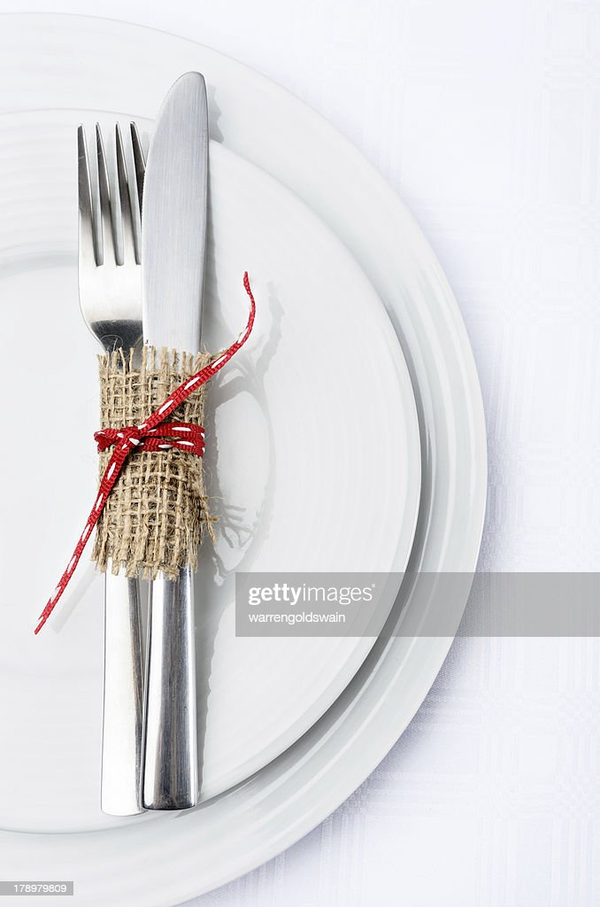 Simple table setting with white plates and silverware & Simple Table Setting With White Plates And Silverware Stock Photo ...