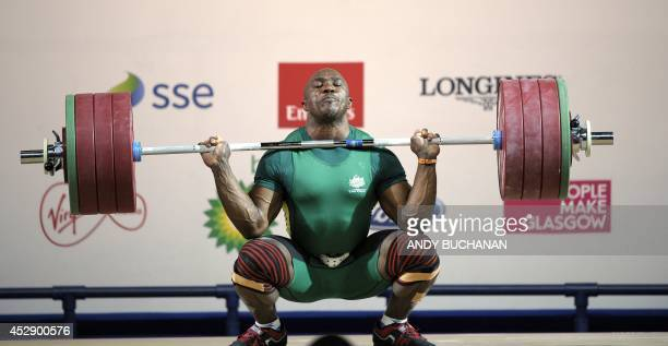 Simplice Ribouem of Australia competes in the Men's 94kg weightlifting final at the SECC Precinct during the 2014 Commonwealth Games in Glasgow on...