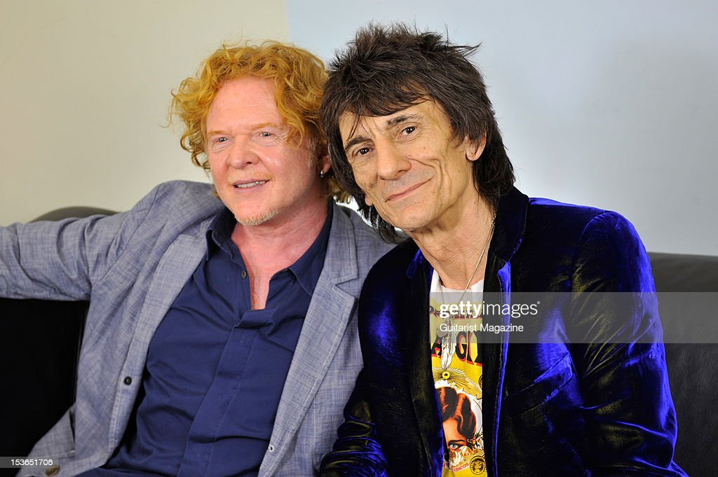 Simply Red frontman Mick Hucknall (L) and Rolling Stones guitarist Ronnie Wood. During a portrait shoot and interview for Guitarist Magazine, June 28, 2011.