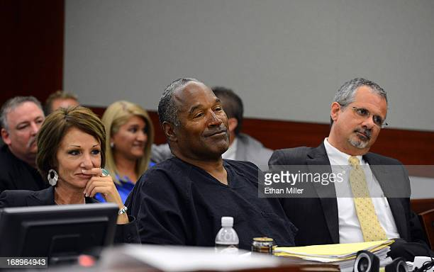 J Simpson and his defense attorneys Patricia Palm and Ozzie Fumo listen during an evidentiary hearing in Clark County District Court on May 17 2013...