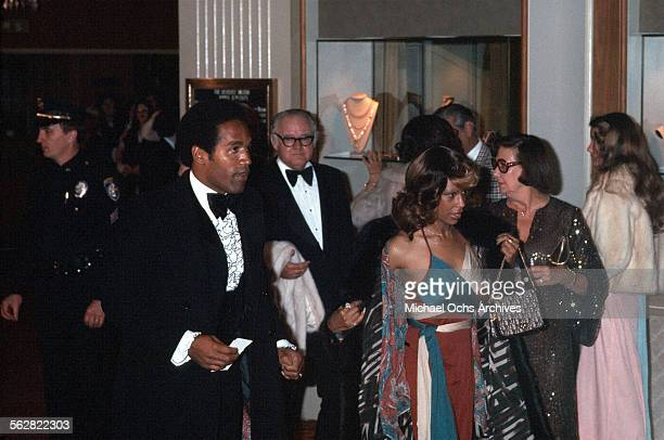 Simpson and his wife Marguerite Whitley arrive to the 47th Academy Awards at Dorothy Chandler Pavilion in Los AngelesCalifornia