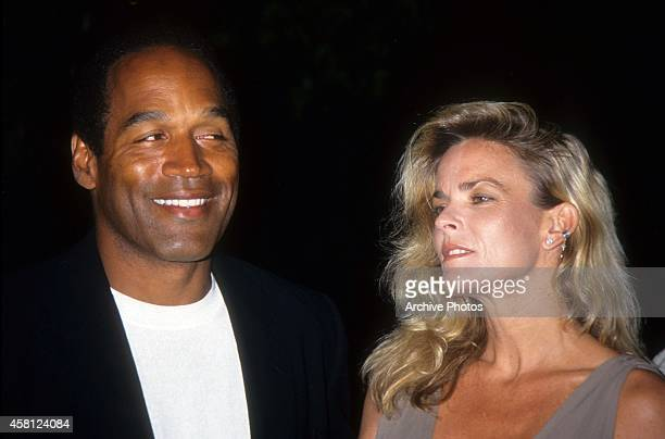 J Simpson and Nicole Brown Simpson pose at the premiere of the 'Naked Gun 33 1/3 The Final Isult' in which OJ starred on March 16 1994 in Los Angeles...