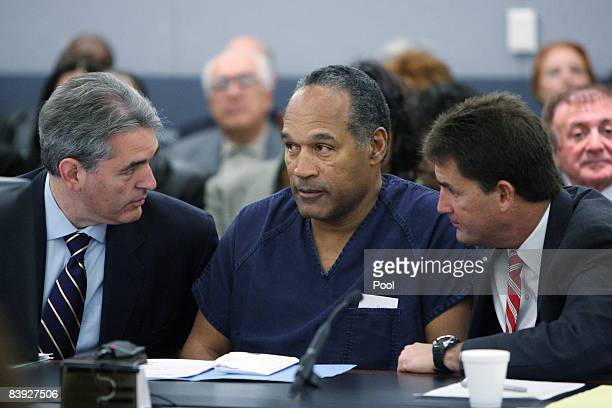 J Simpson appears in court with attorneys Gabriel Grasso and Yale Galanter prior to sentencing at the Clark County Regional Justice Center December 5...