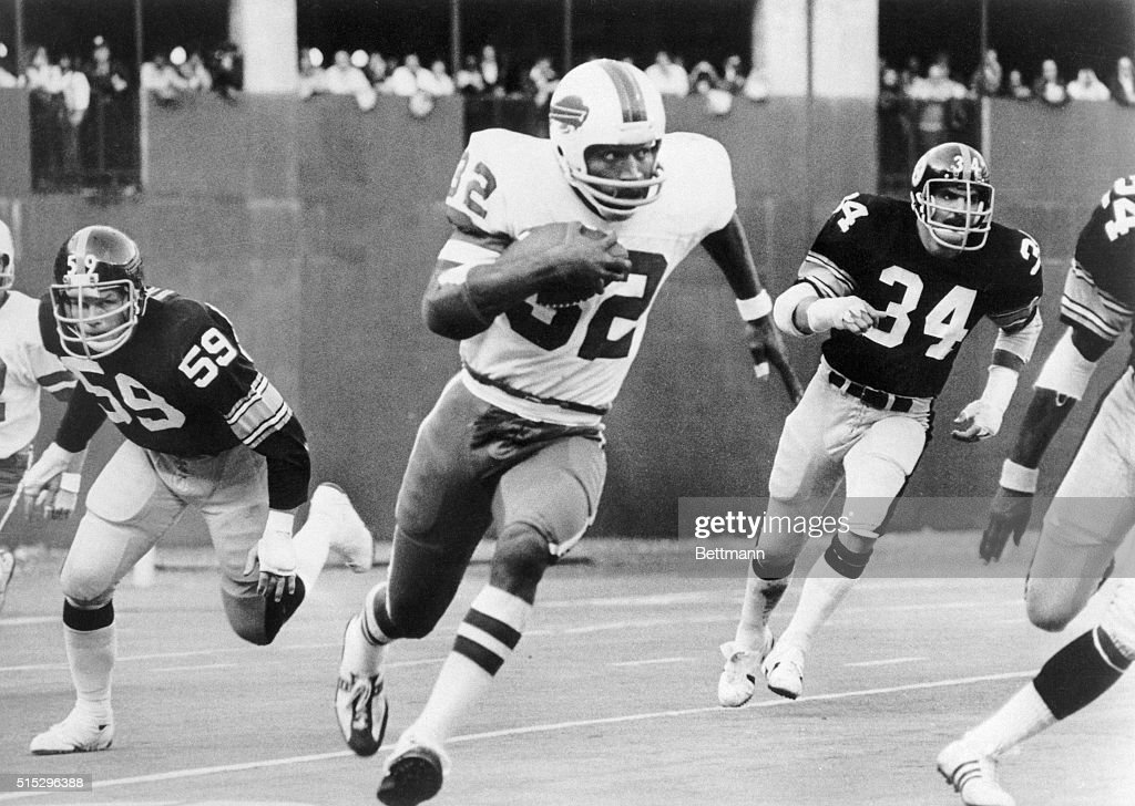 OJ Simpson breaks away from Steeler tacklers Jack Russell and Andy Russell to run 87yards for a touchdown in the third quarter of the game