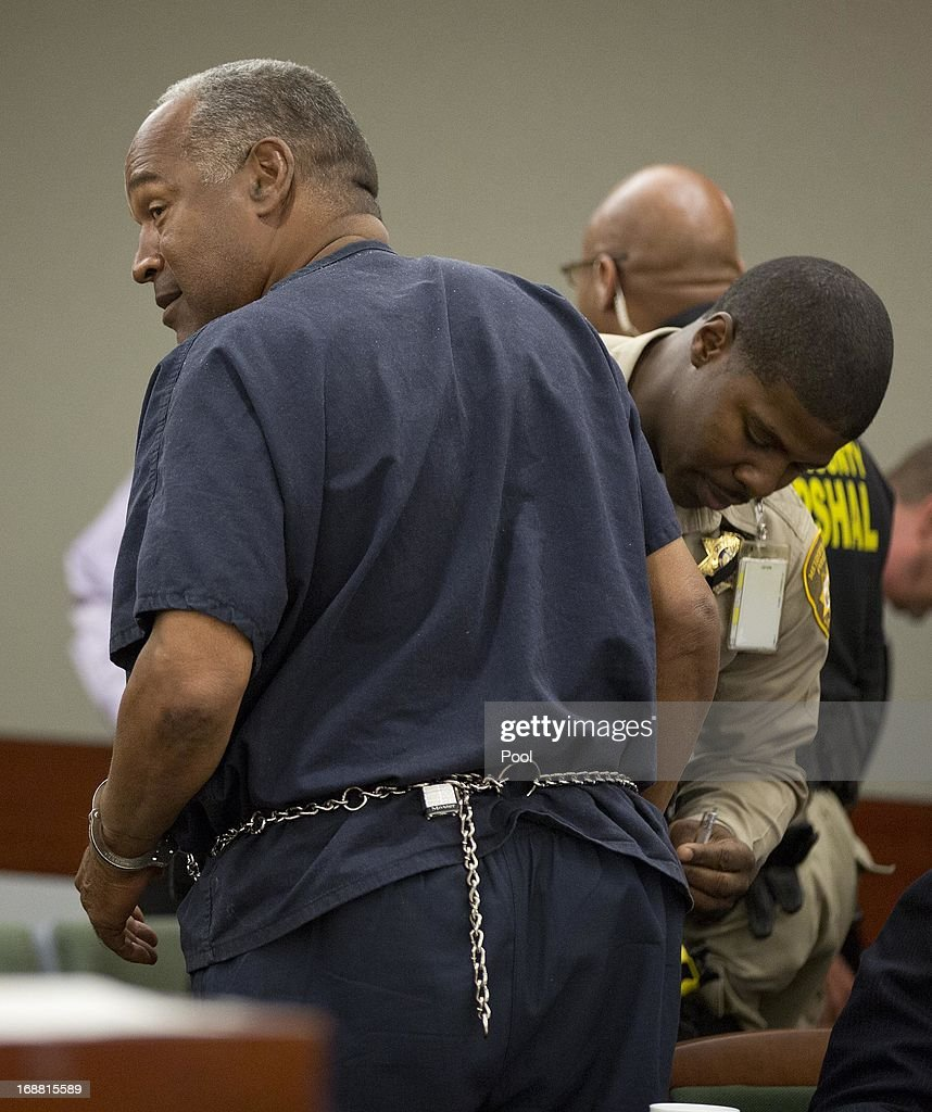 O.J. Simpson is handcuffed by Clark County corrections officer George Gafford after testifying during an evidentiary hearing in Clark County District Court May 15, 2013 in Las Vegas, Nevada. Simpson, who is currently serving a nine to 33-year sentence in state prison as a result of his October 2008 conviction for armed robbery and kidnapping charges, is using a writ of habeas corpus to seek a new trial, claiming he had such bad representation that his conviction should be reversed.