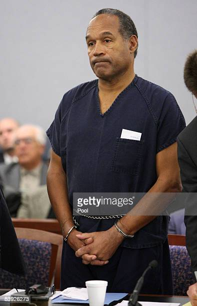 J Simpson listens as District Court Judge Jackie Glass reads his sentence at the Clark County Regional Justice Center December 5 2008 in Las Vegas...