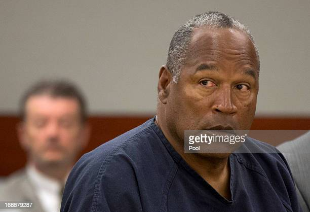J Simpson listens as his defense attorney Ozzie Fumo questions witness David Cook during an evidentiary hearing in Clark County District Court May 16...