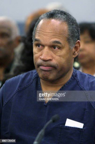 OJ Simpson listens to District Court Judge Jackie Glass prior to sentencing at the Clark County Regional Justice Center December 5 2008 in Las Vegas...