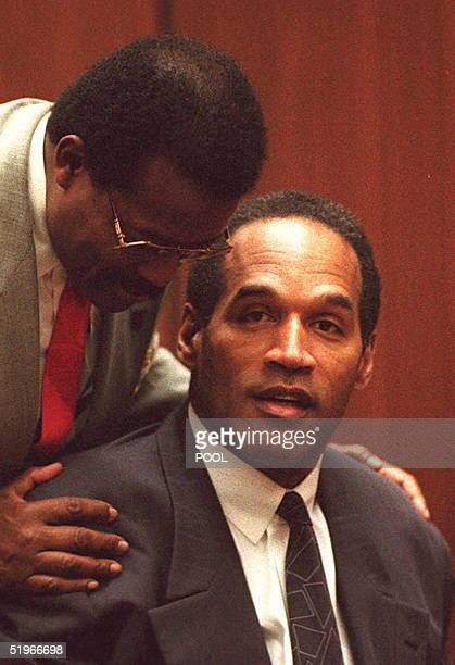 J Simpson listens to his lawyer Johnnie Cochran 01 December in Los Angeles Alternate jury selection continued for the doublemurder trial Defense...