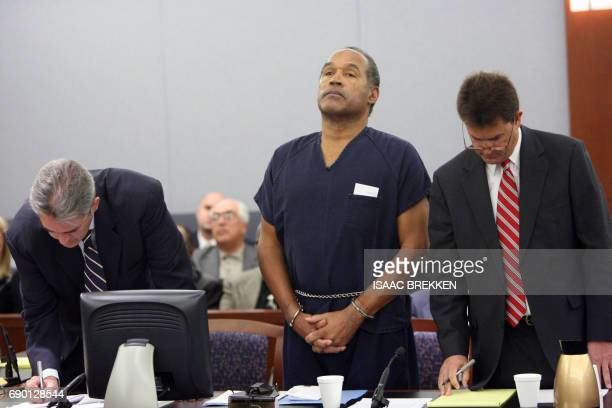 OJ Simpson listens with his attorneys Gabriel Grasso and Yale Galanter during his sentencing at the Clark County Regional Justice Center December 5...