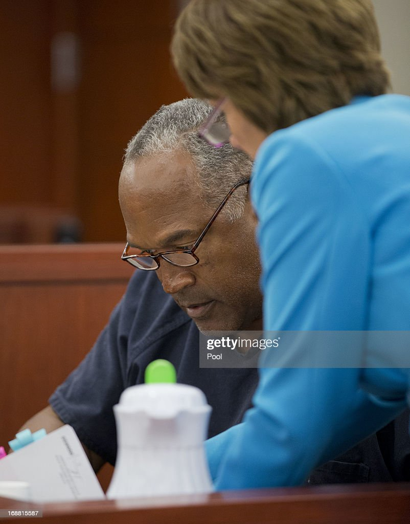 <a gi-track='captionPersonalityLinkClicked' href=/galleries/search?phrase=O.J.+Simpson&family=editorial&specificpeople=123848 ng-click='$event.stopPropagation()'>O.J. Simpson</a> looks over documents presented by defense attorney Patricia Palm while testifying during an evidentiary hearing in Clark County District Court May 15, 2013 in Las Vegas, Nevada. Simpson, who is currently serving a nine to 33-year sentence in state prison as a result of his October 2008 conviction for armed robbery and kidnapping charges, is using a writ of habeas corpus to seek a new trial, claiming he had such bad representation that his conviction should be reversed.