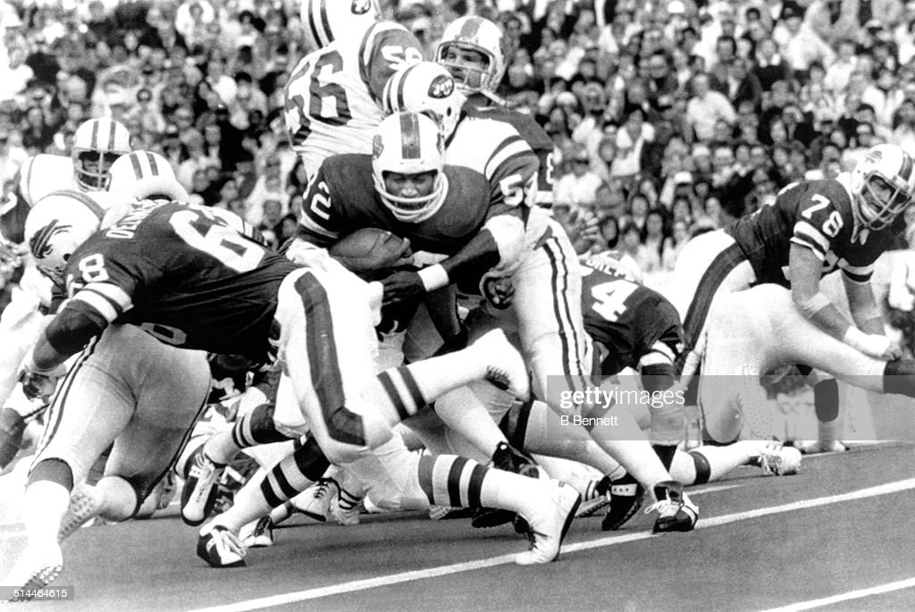 O.J. Simpson #32 of the Buffalo Bills grimaces as he is tackled by Jamie Rivers #54 of the New York Jets on September 21, 1975 at Rich Stadium in Orchard Park, New York.