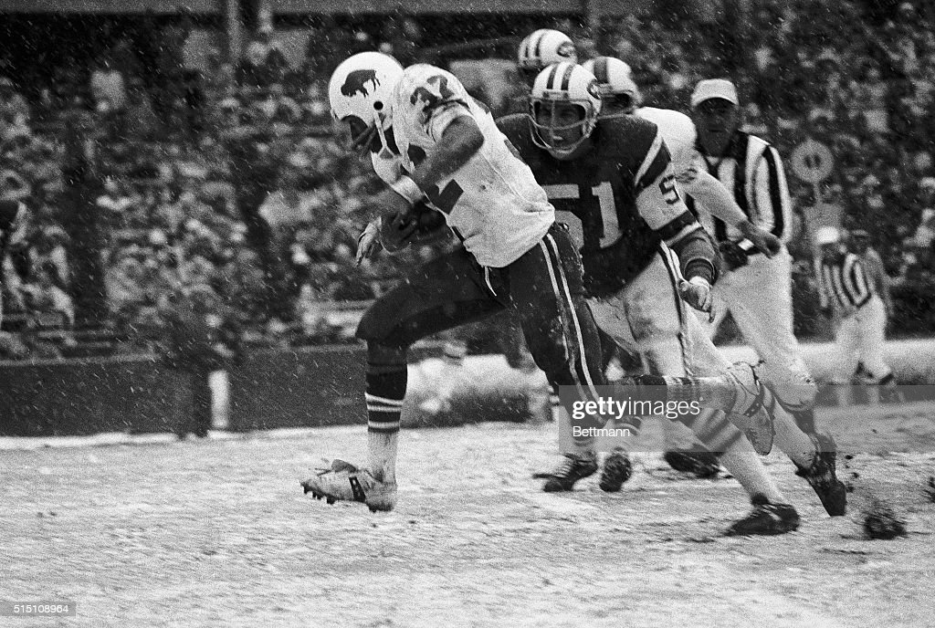 OJ Simpson of the Buffalo Bills heads for the goal line on a 13yard run in the second quarter against the NY Jets Ralph Baker of the Jets is helpless...