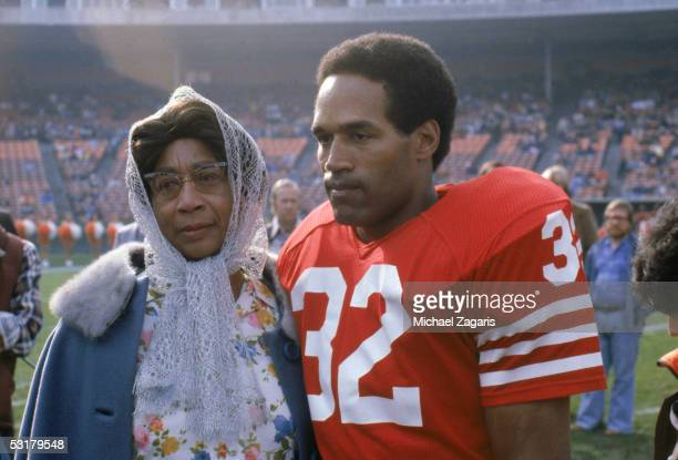 O J Simpson of the San Francisco 49ers stands with his mother after the NFL game against the Tampa Bay Buccaneers at Candlestick Park on December...